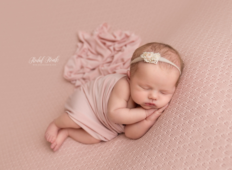 Newborn Photography Brooklyn, NYC, baby asleep on side wrapped in peach blanket