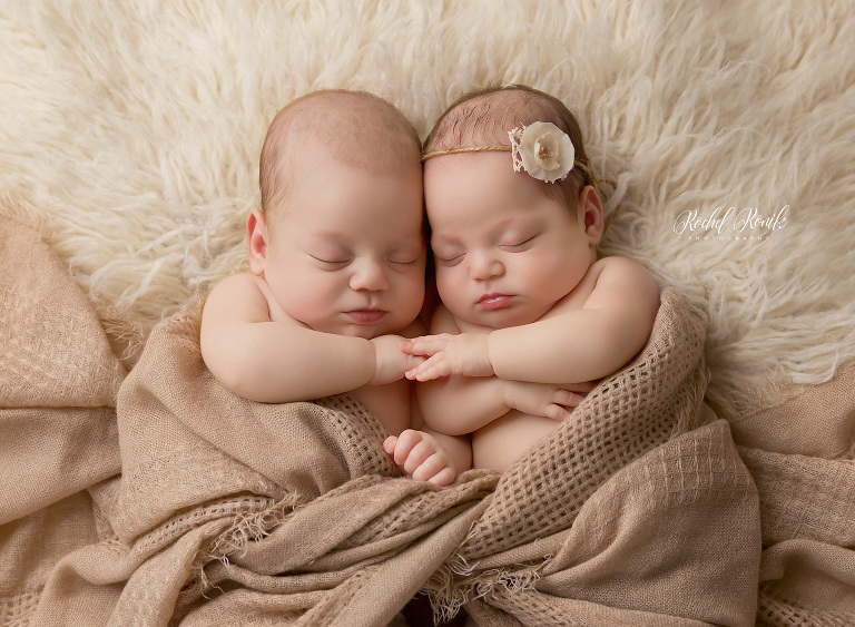 Newborn Photography Brooklyn, NYC, twins asleep in brown blanket holding hands