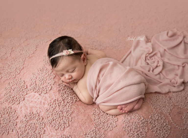 baby girl asleep on a pink blush backdrop, newborn photography